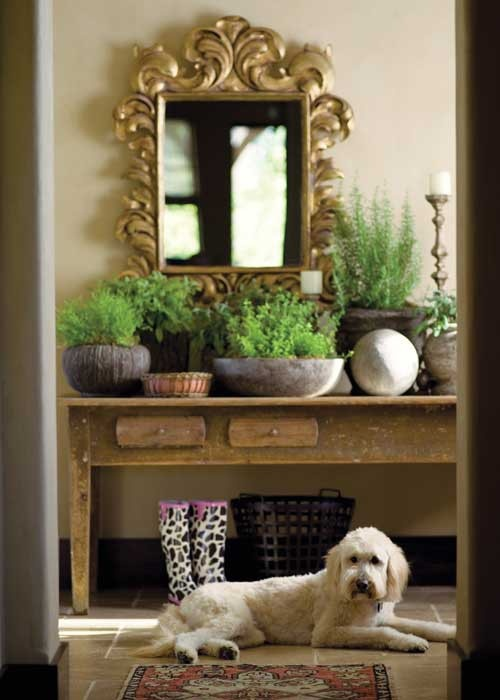 ornate mirror with farm house style table