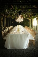 formal out door dining white tablecloth, chandelier