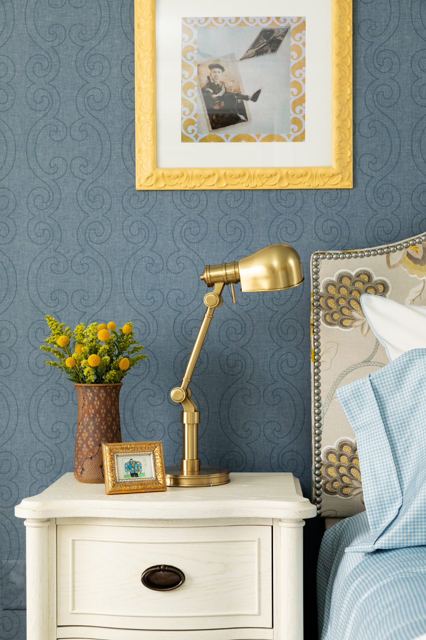 white nightstand with gold lamp
