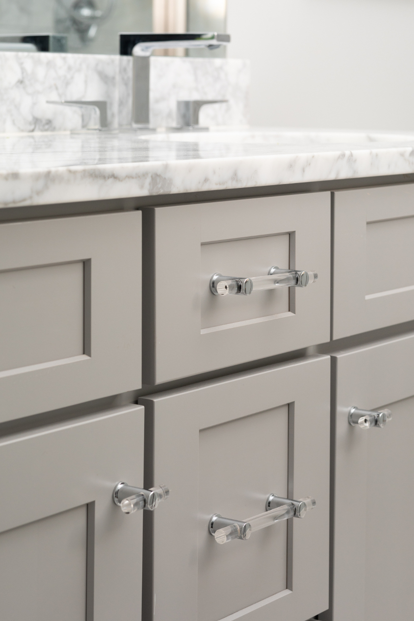 Lucite hardware on gray cabinetry
