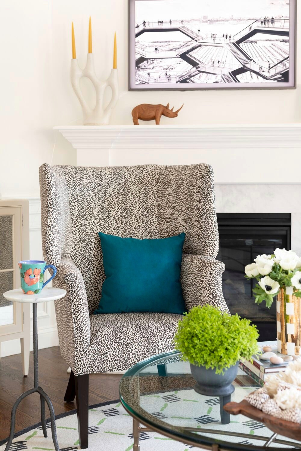 animal print chair and blue pillow