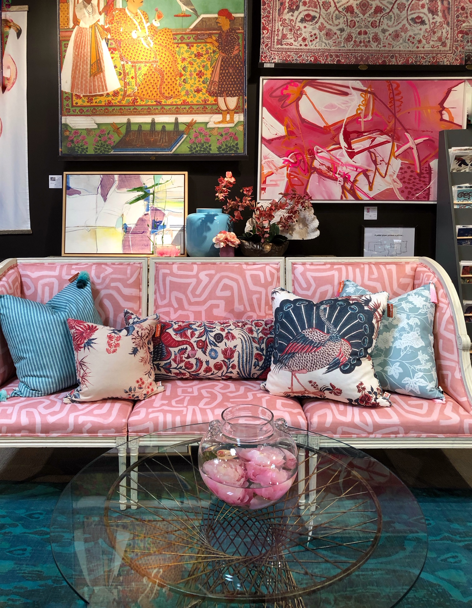 pink sofa with colorful patterned pillows