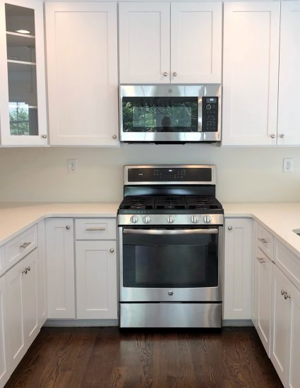white kitchen with stainless steel and brushed nickel hardware
