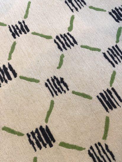 white black and green rug