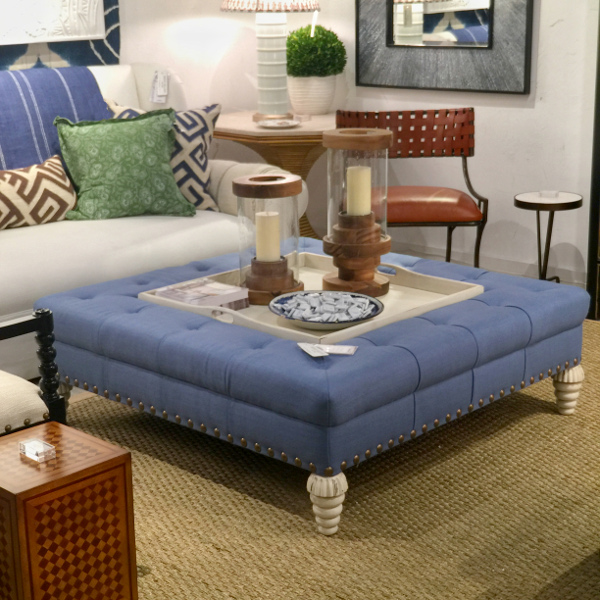 Bunny William's Home blue tufted ottoman used as coffee table