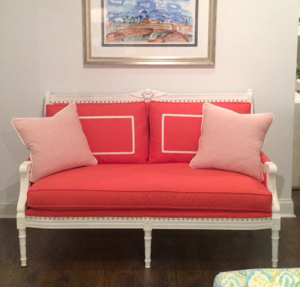 white bench with hot pink fabric