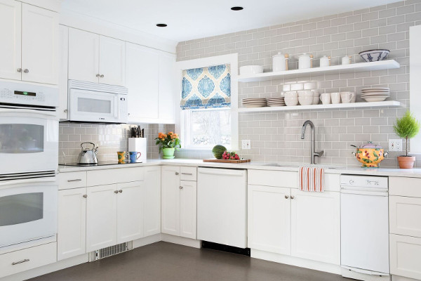 white cabinets, open shelving, subway tiles, cork floor white kitchen