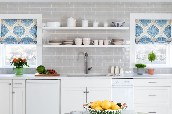 Gray subway tile back splash white cabinets , open shelves in kitchen