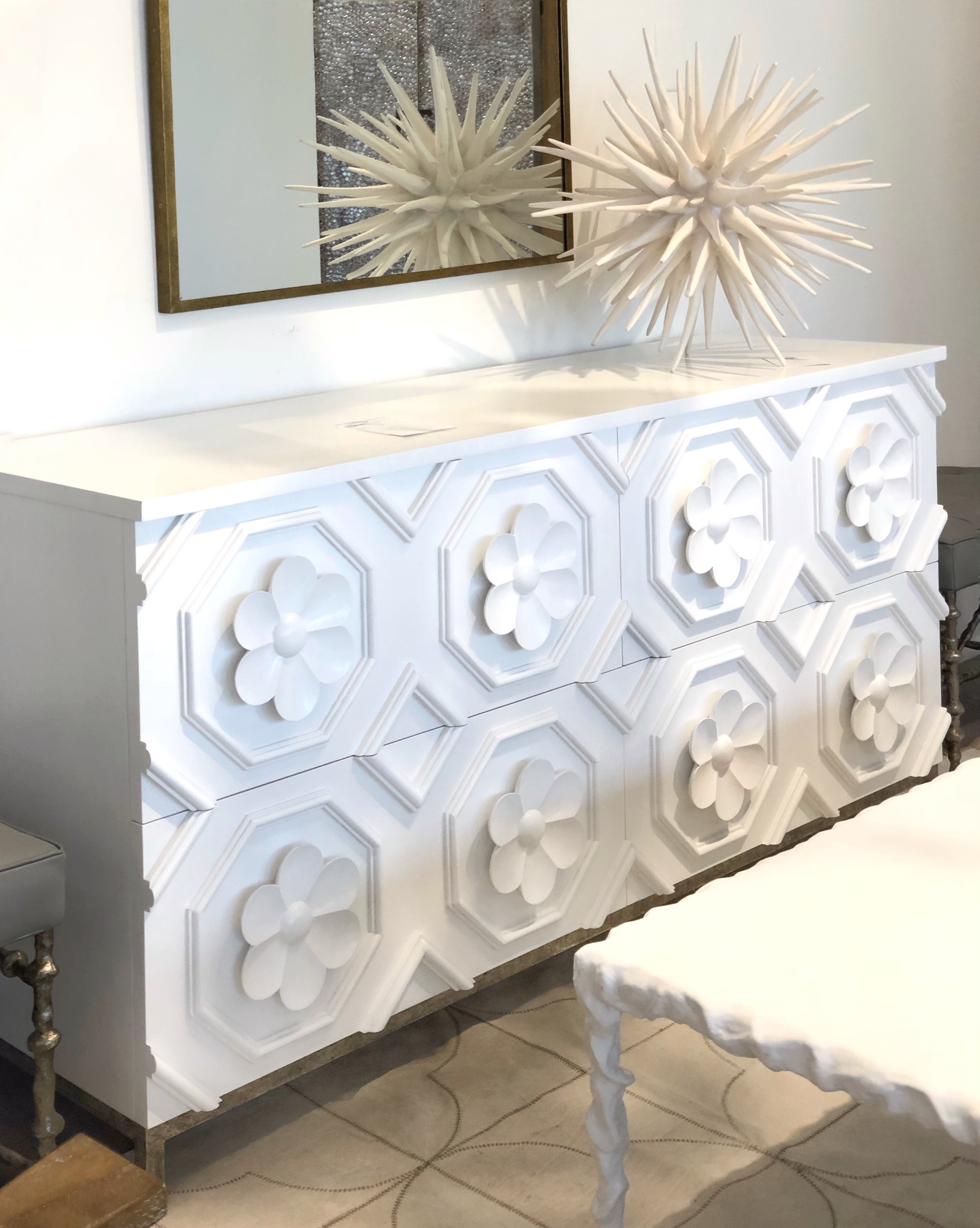 white console cabinet with flower detail