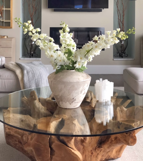 drift wood coffee table with white flowers