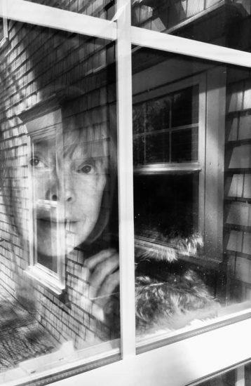 self portrait looking out window