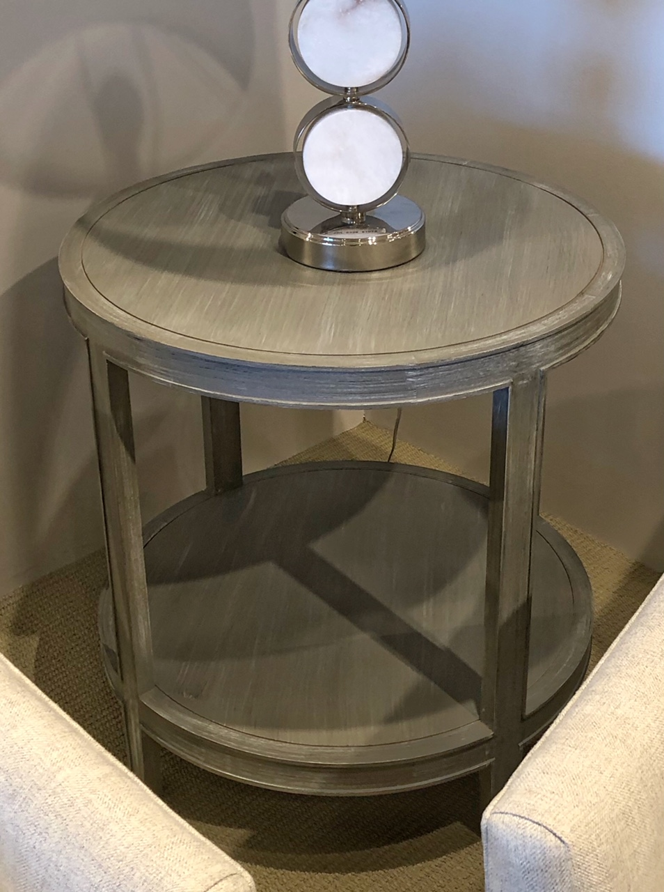 Round gray side table from Century