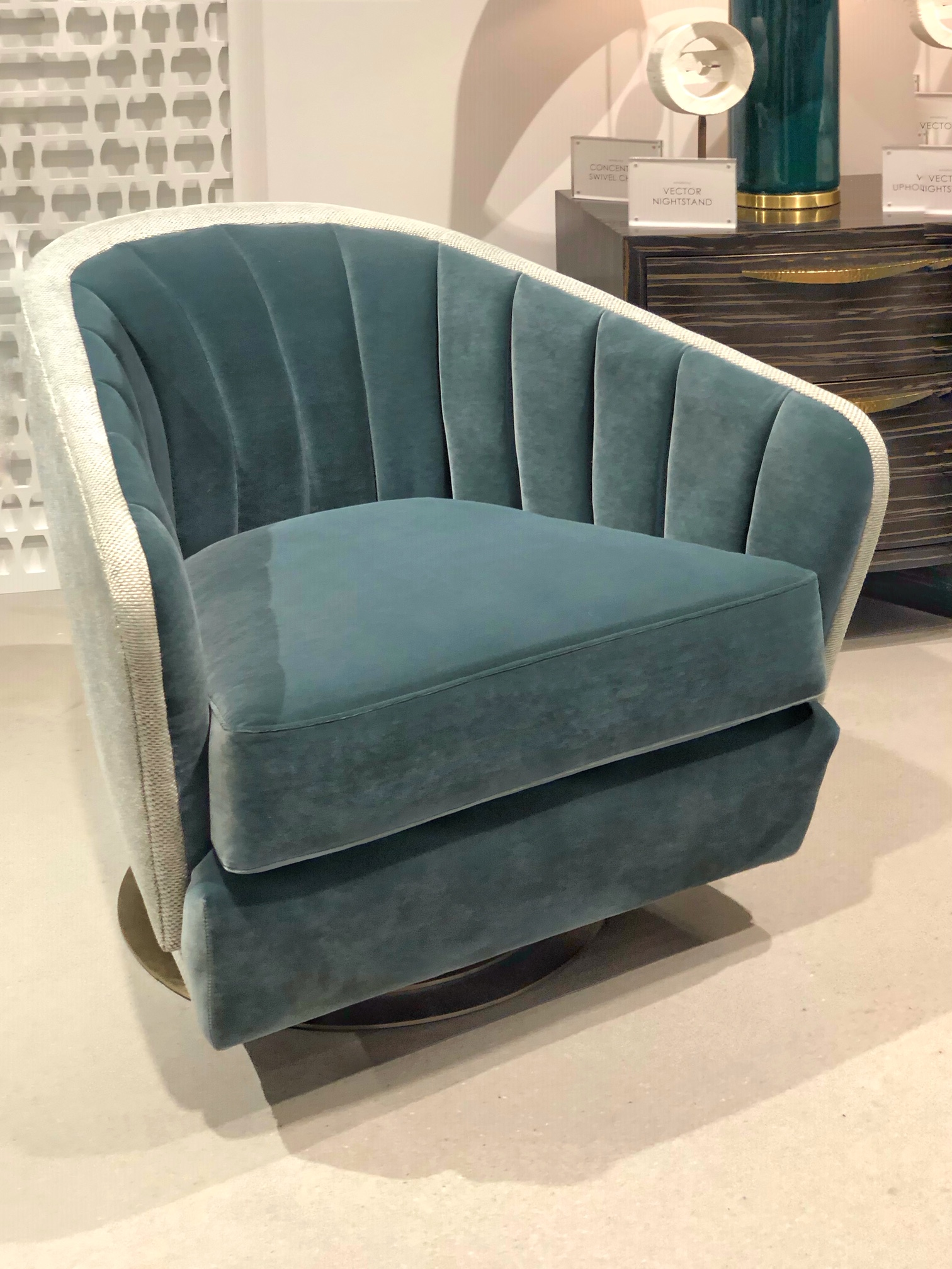teal colored channel back swivel chair
