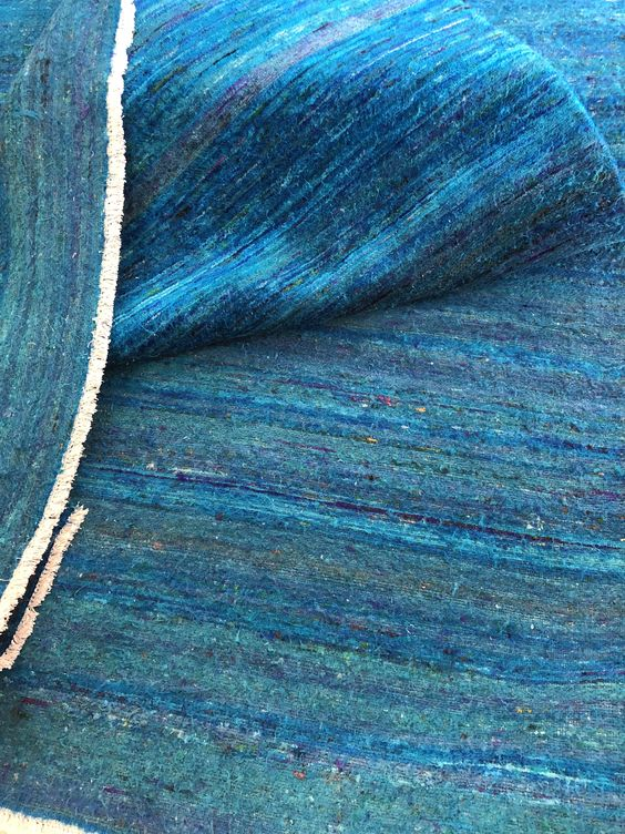 bright blue rug made from recycled silk sari