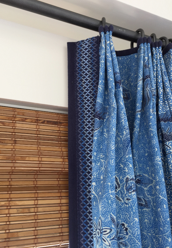 blue drapery with leading edge trim
