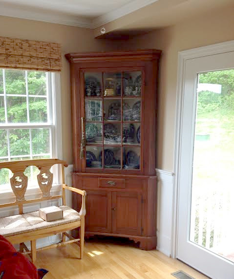 antique corner cabinet is staying
