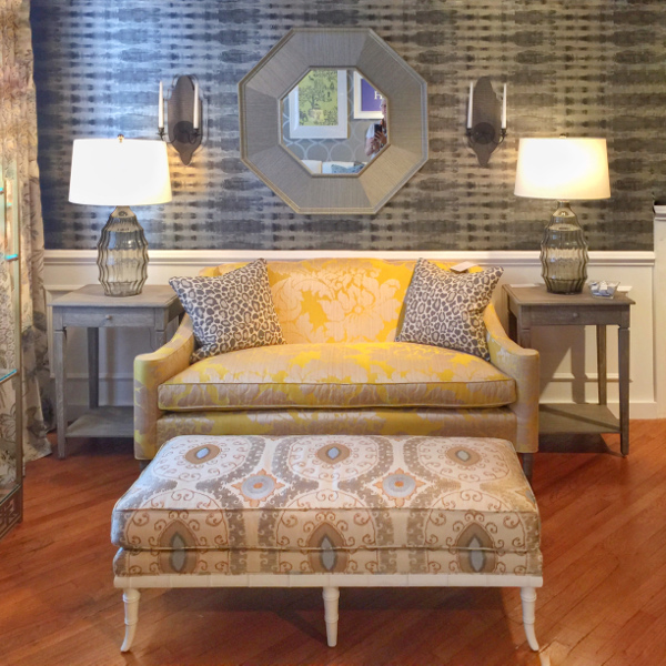 Thibaut Home. On trend wallpaper with traditional yellow love seat and fabric ottoman