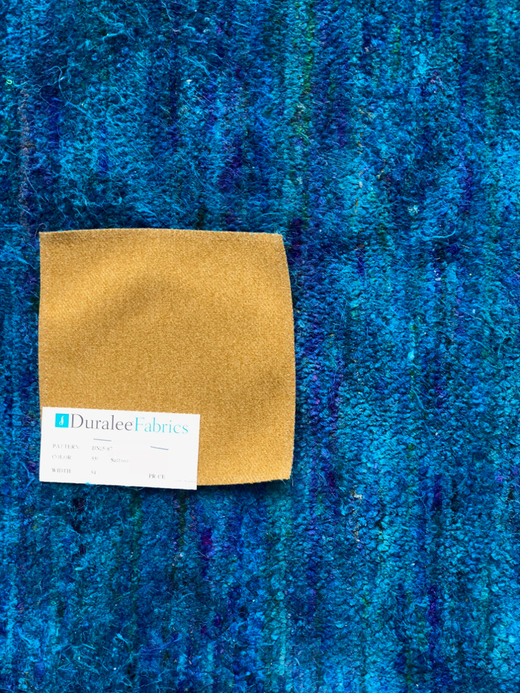 blue rug with yellow fabric