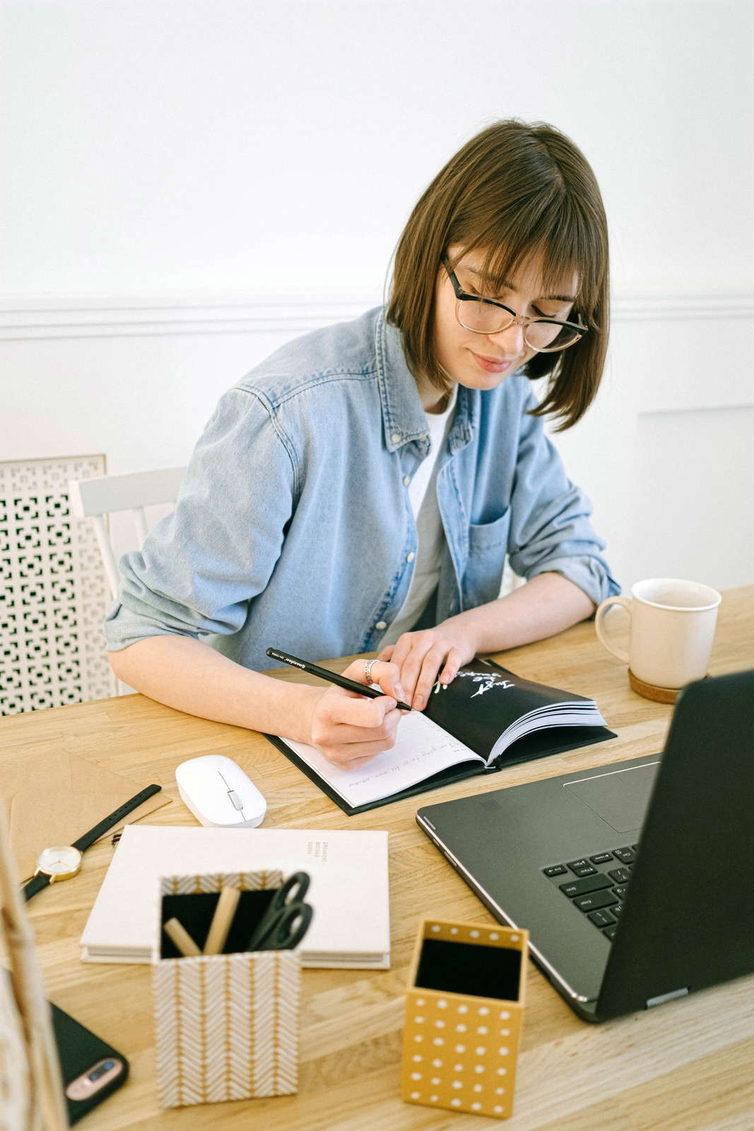 woman working at dining table