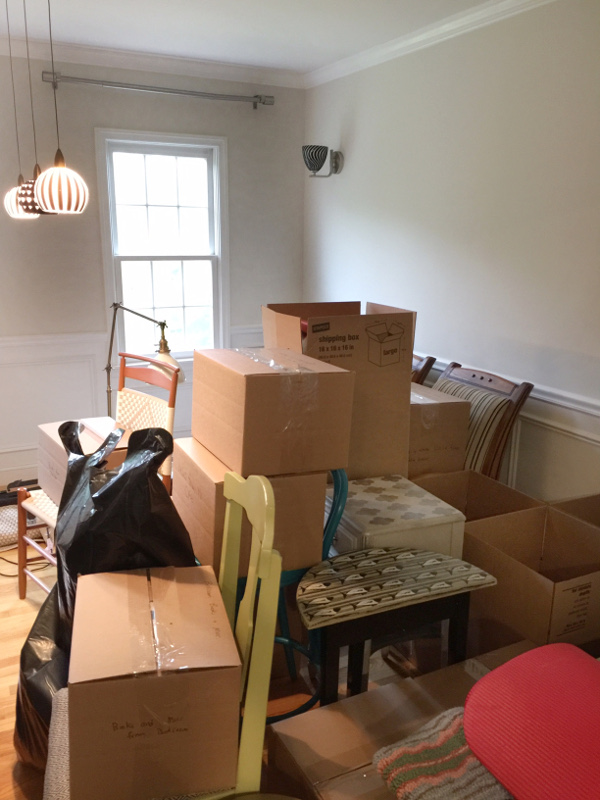 moving boxes piled high ready for movers