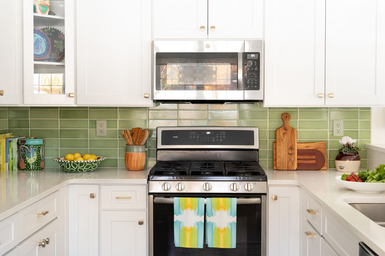 white kitchen cabinets green back splash tiles