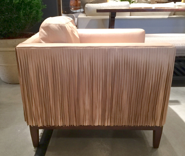 Blush pink leather chair with on trend fringe