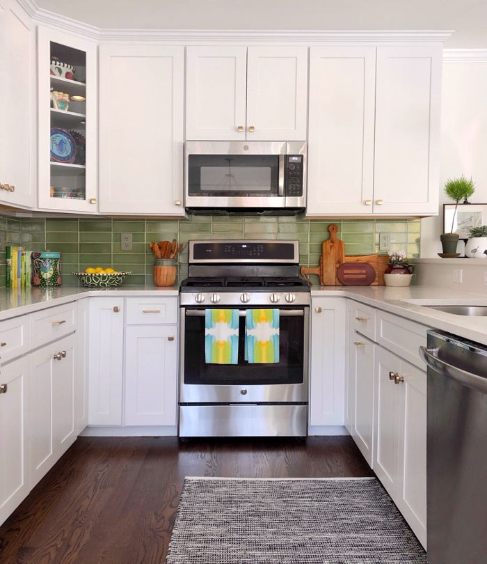 white cabinets green back splash tiles