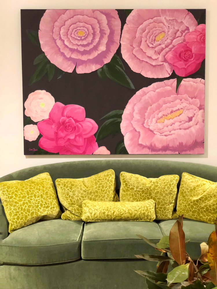 green sofa pink artwork color trends