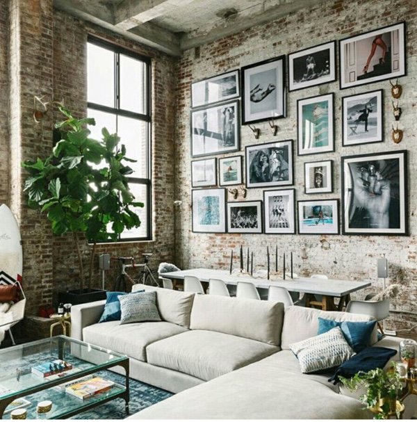 city loft with brick wall and artwork