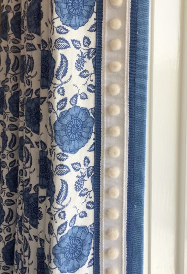 patterned drapes with decorative trim