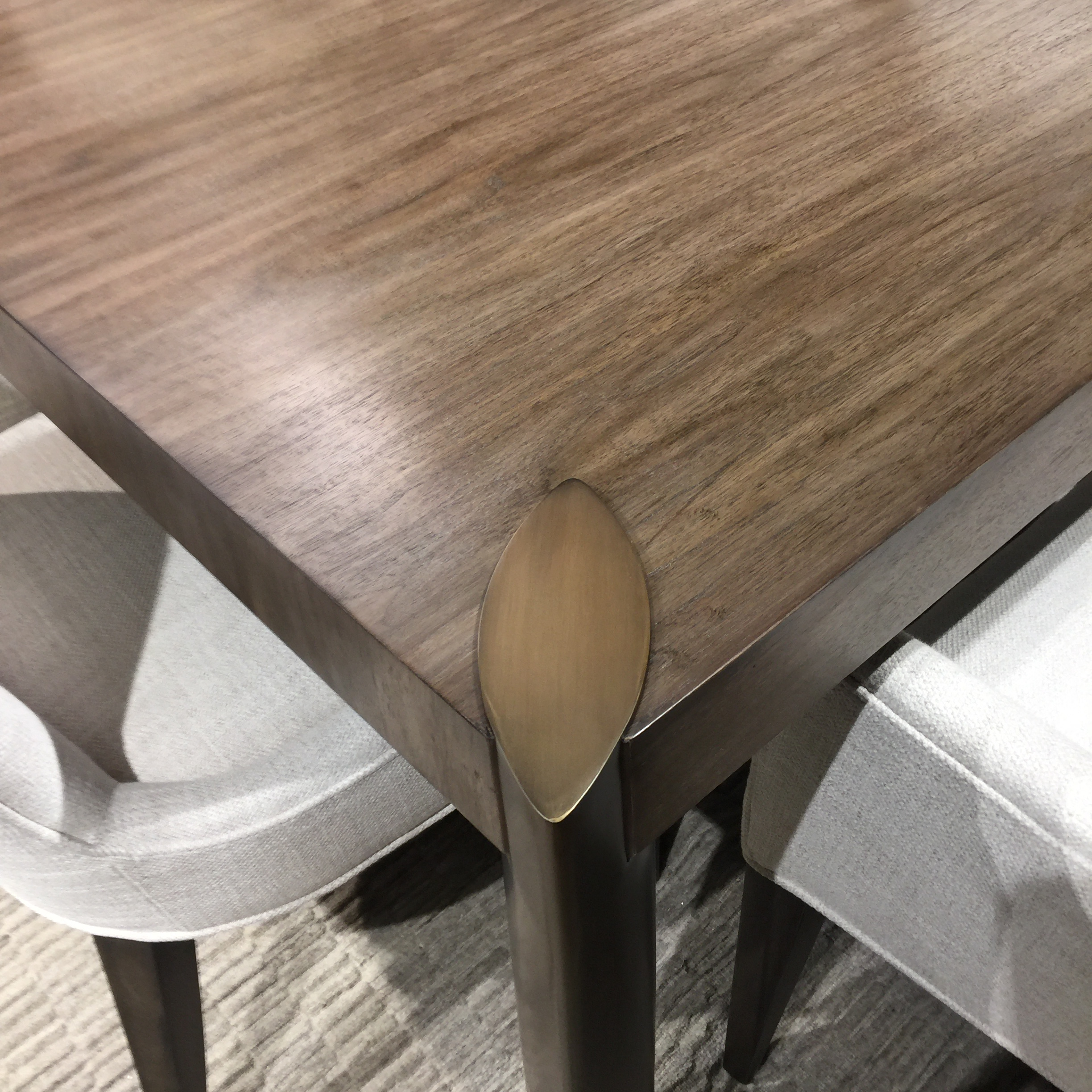 wood table accented with brass legs