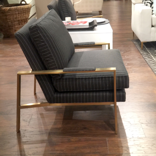 chair with brass arms and menswear inspired fabric