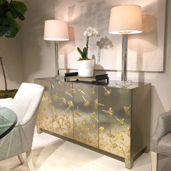 gold ginkgo leaves on silver console