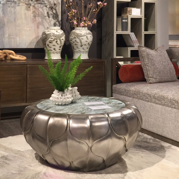 silver metal pod table with glass top