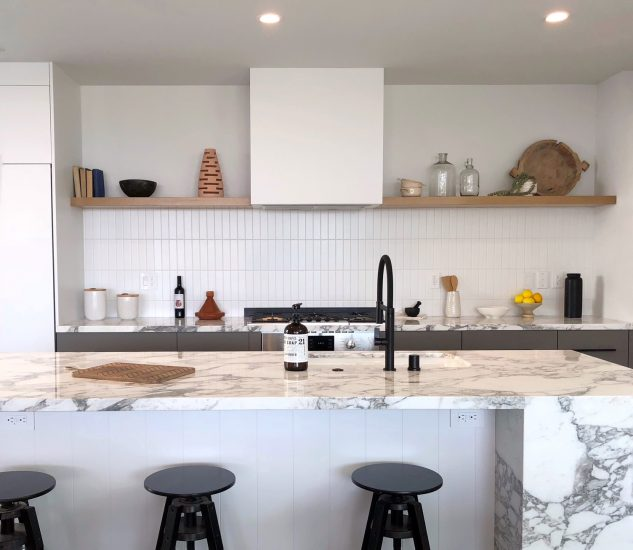 black and white kitchen with open shelving