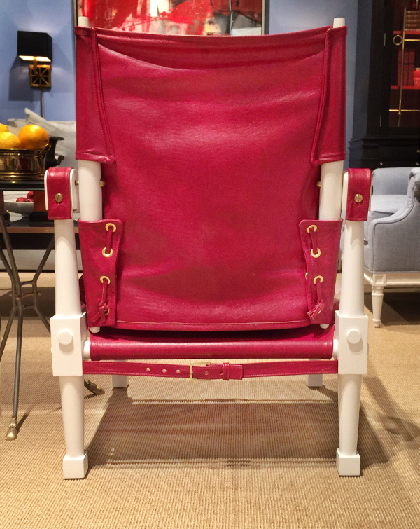 red leather chair with belt and grommets