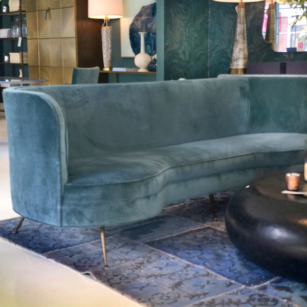 teal velvet sofa with stiletto like gold legs