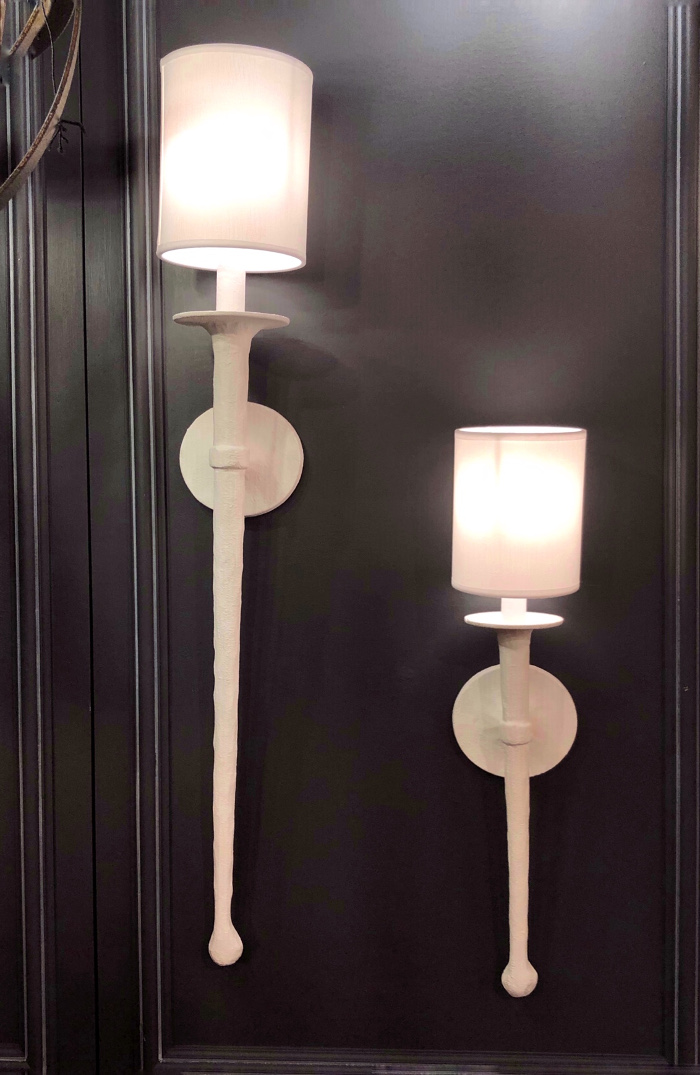 white plaster sconces