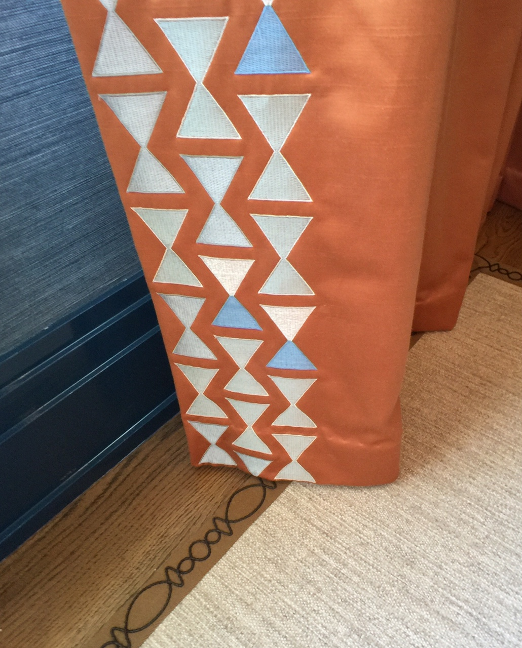 orange drapes with embroidery edge