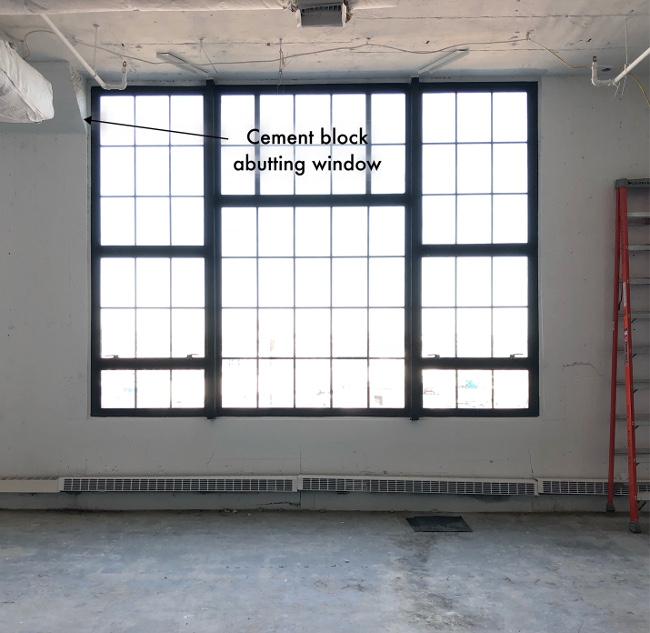 Cement block abutting window